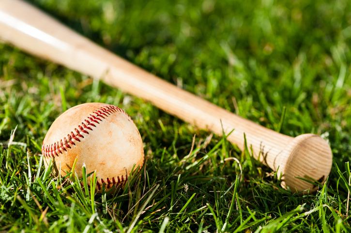 Baseball Bat and Ball on Grass Field